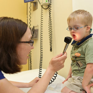 Young boy with Down syndrome with clinician