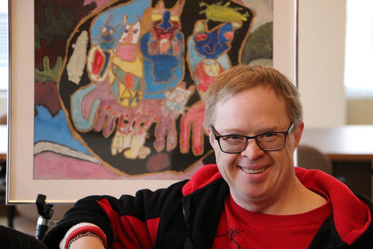 Dan Campbell with artwork