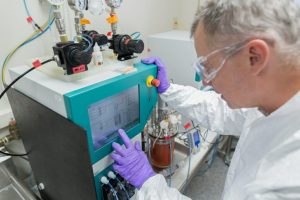 Waisman Biomanufacturing staff member Alan Bettermann optimizing bioreactor process at small scale.