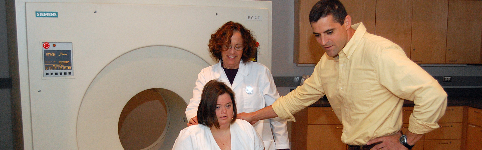 Brad Christian plus research participant in front of PET Scanner