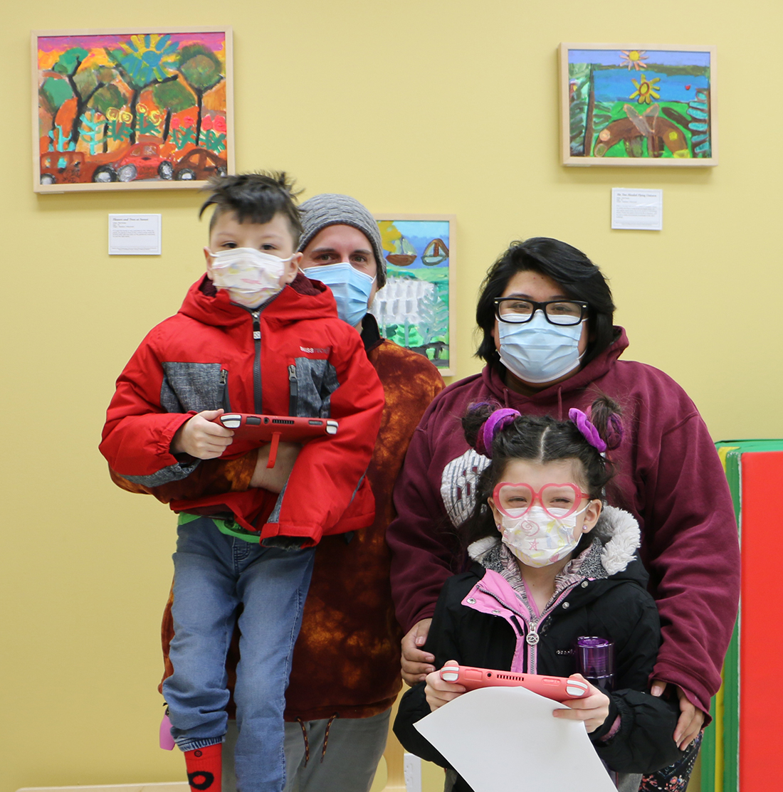 The Sundly Family at Waisman's cerebral palsy clinic. Left to right: Sebastian, Kevin, Kendra and Charlotte (in front).